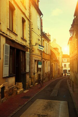 Traditional architecture of Auxerre old narrow streets, France Imagens