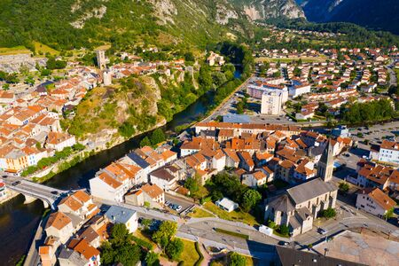 Aerial view of old stone houses and streets of Tarascon-sur-Ariege, France