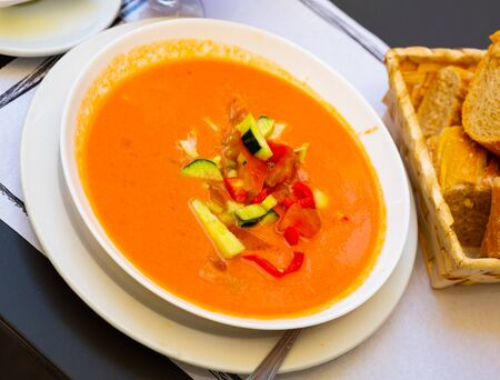 Tomato soup Gazpacho served with baguette – traditional Spanish dish