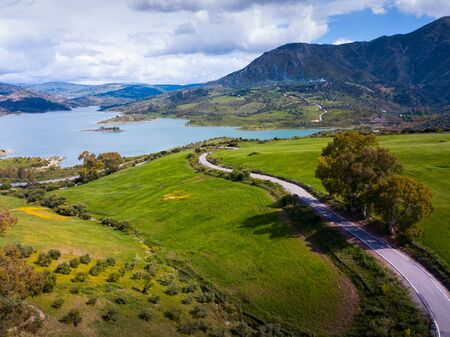 Aerial view of spring landscape of Zahara-el Gastor reservoir, artificial lake surrounded by mountains and hills, Spain