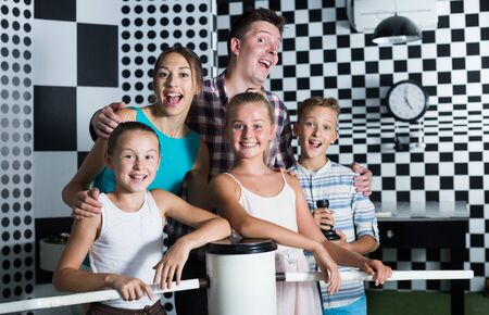 Portrait of family who is satisfied of visit of entertainment styling chessroom. Stock fotó
