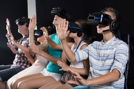 Family are watching video in the room of virtual reality