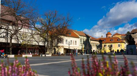 EGER, HUNGARY - OCTOBER 30, 2017: Cityscape of Eger on background with medieval Castle stone walls and towers