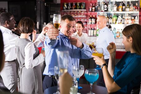 Drunken man in business suit having fun at corporate party Stock Photo