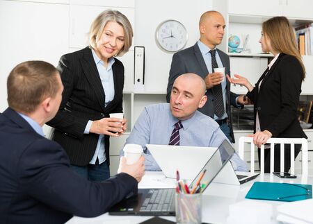 Business people developing strategy in modern office