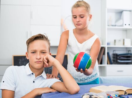 Girl is apologizing to a friend for bad behavior and offering to play ball at home.