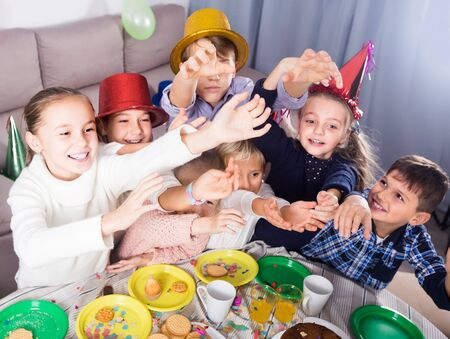 active kids having good time during friend's birthday party