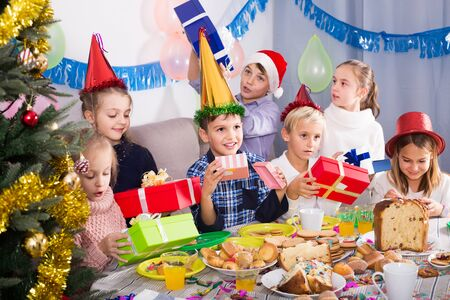 happy germany children presenting gifts during Christmas dinner