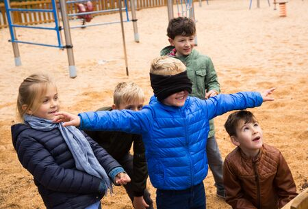 Children play in the blind man's buff