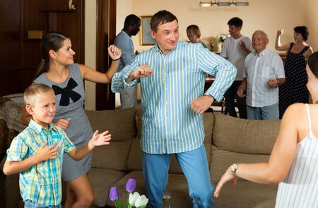 Happy large family having fun and dancing together at home