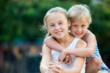 Portrait of two girls playmates outdoors in summer day Stock Photo