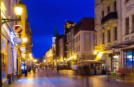 View of illuminated streets of Polish town of Torun in evening