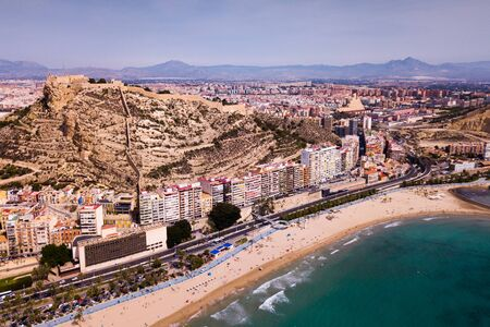 Picturesque panorama of coastal area of Spanish town of Alicante overlooking of Castle of Santa Barbara on Mount Benacantil
