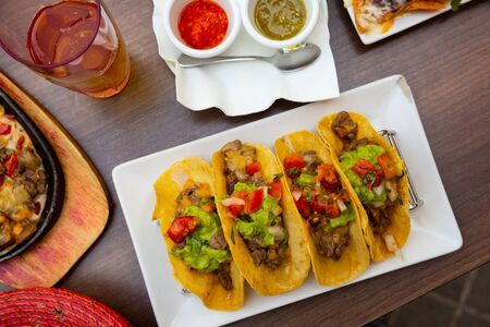 Image of beef tacos, vegetables  and guacamole, dish of Mexican cuisine
