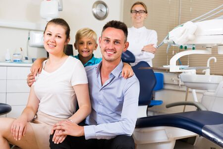 People are visiting dentist in clinic.