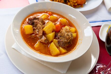 Delicious lamb soup with potatoes. Traditional oriental dish