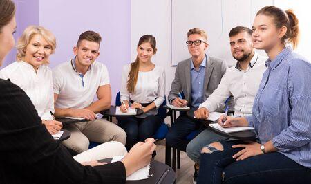 Portrait of group of students listening teacher in classroom Reklamní fotografie