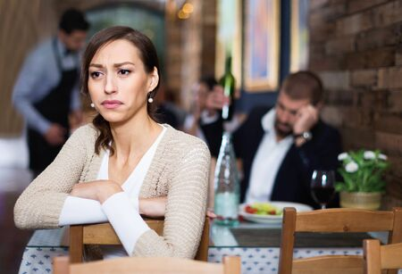 Portrait of evil man and woman in the restaurant on meeting 스톡 콘텐츠