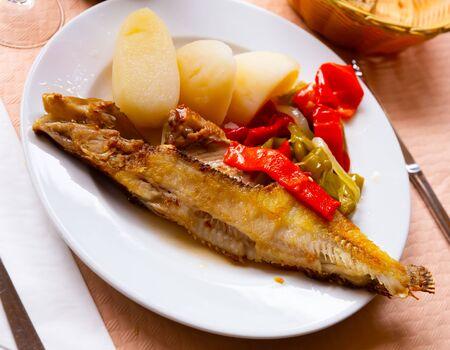 Roasted ballan wrasse (maragota) served with marinated vegetables and potato – Spanish fish dish