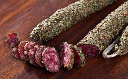 Sliced spanish sausage fuet with herbs Zdjęcie Seryjne