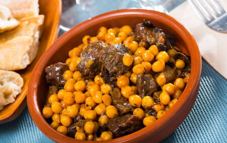 Beef stew with chickpeas in a clay plate