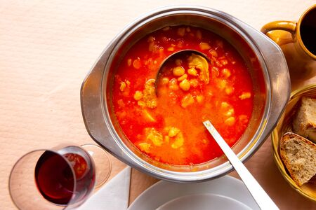 Hot Callos a la gallega stew – traditional dish of Galician cuisine. Rich pork tripe broth with vegetables