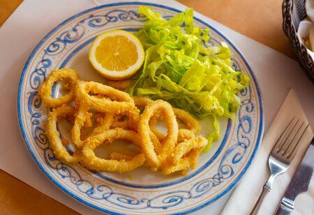 Crispy squid rings in batter Roman style. Traditional spanish dish