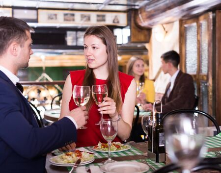 Lovely couple is dining together in luxurious restaurant.