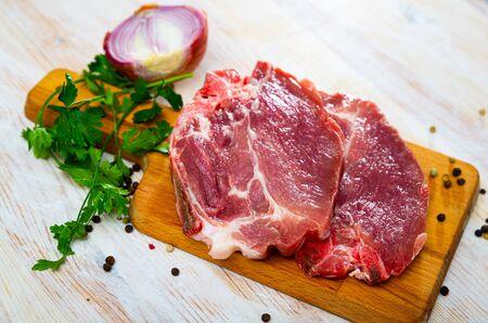 Raw meat, two fresh pork cutlets on wooden cutting board Stok Fotoğraf