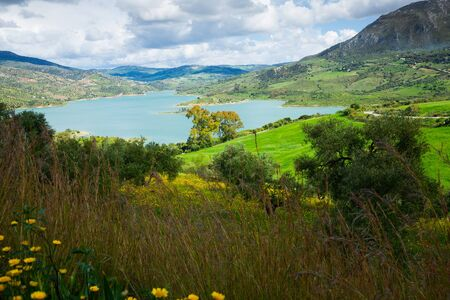 Panoramic scenic view of blue lake and green valley in Zahara, Spain