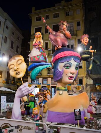 VALENCIA, SPAIN - MARCH 18, 2019: Giant colorful artistic monument (falla) created of comic figures (ninots) for parade on city streets during traditional Falles celebration Sajtókép