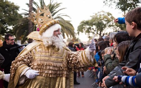 BARCELONA, SPAIN –  JANUARY 5, 2017: King-magician Melchor and his retinue take letters from children. Barcelona, Spain Publikacyjne