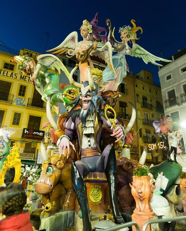 VALENCIA, SPAIN - MARCH 18, 2019: Grotesque colorful doll statues (ninot) imaging famous people, cartoon and mythic characters on traditional spring festival Fallas Sajtókép