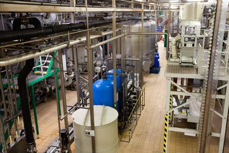 PILSEN, CZECH REPUBLIC - OCTOBER 10, 2019: Inside view of bottling department of Pilsner Urquell brewery with beer bottles on conveyor belt
