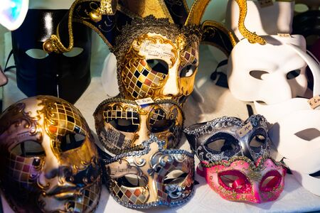 Traditional venician masks on shelves in shop in Venice, Italy