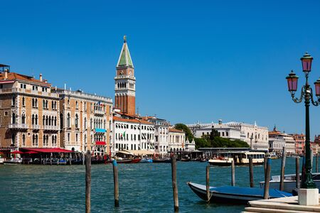Picturesque view of Venice Grand Canal with gondolas and old buildings on banks of canal