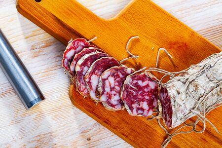 Salami – traditional Italian thin dried sausage Stock Photo