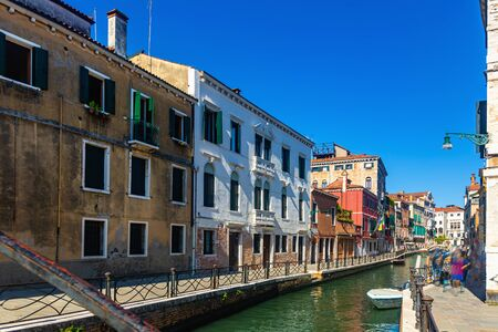 Picturesque view of canals in romantic Italian city of Venice in sunny summer day