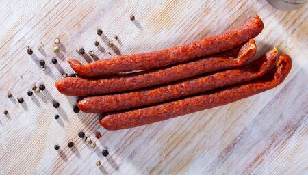Appetizing smoked sausages for snacks
