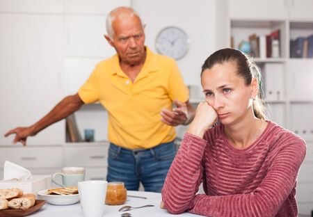 Mature father scolds adult daughter