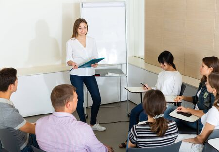 Female manager making presentation on staff meeting at office