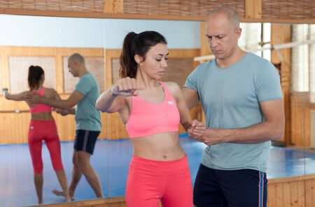 Womens self-defense workout with personal trainer, fighting training in gym Standard-Bild - 133855553