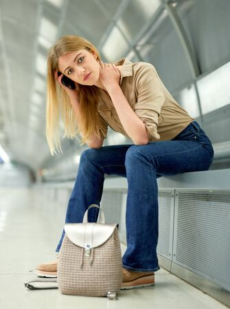 Young woman waiting for train at subway station Stok Fotoğraf - 133949997