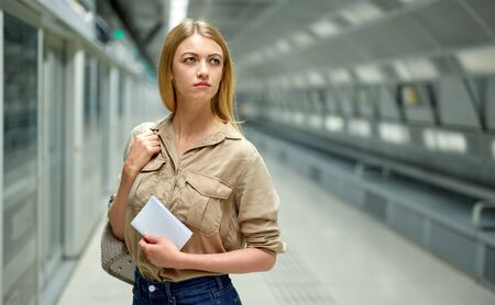Attractive woman waiting for the subway train Stok Fotoğraf - 133951959