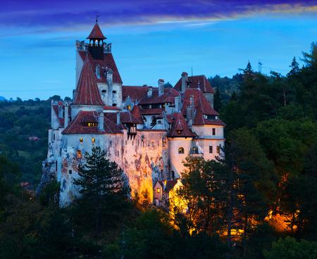 Impressive landscape with famous Bran Castle in evening dusk, Romania 에디토리얼