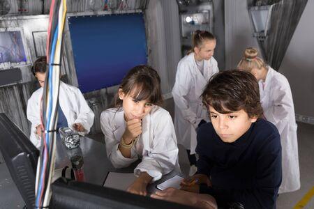 positive american сhildren playing in bunker quest room