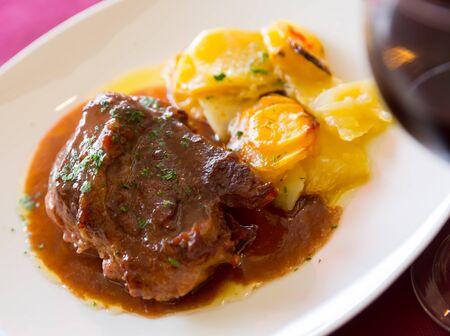 Pork cheeks with dark chocolate and potato, original catalonian dish Galtas al chocolate