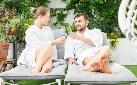 attractive happy young couple relaxing in spa hotel outdoors 写真素材