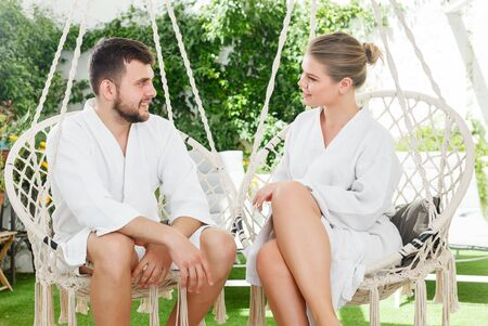 Happy young couple relaxing in spa hotel outdoors