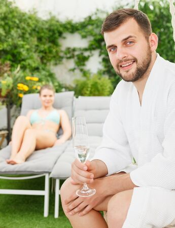 Happy adult man enjoying vacation with sweetheart in luxury spa resort outdoors 写真素材